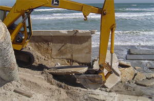 StableCrete applied prevents wet-dry cycle corrosion at splash zone. Oceanfront Seawall Reconstruction, New Smyrna Beach, Florida